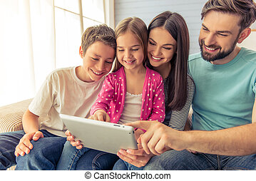 Family at home - Beautiful young parents, their cute little...