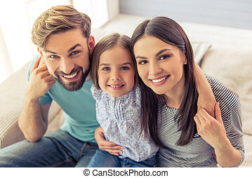 Family at home - Portrait of beautiful young parents and...