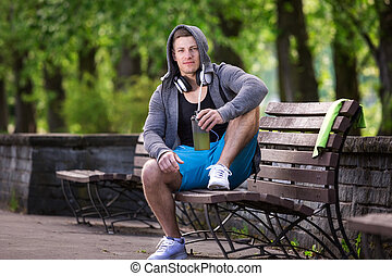 Man taking rest in the park - A photo of young, handsome man...