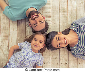 Happy family together - Top view of beautiful young parents...