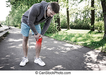Man having knee injury - A photo of young man having knee...