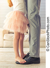 Father and daughter - Cropped image of young father and his...