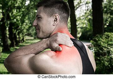 Throbbing pain - A photo of sporty man suffering from nape...