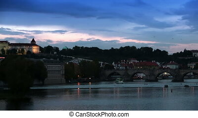 Cityscape of Prague at night with Charles Bridge Karluv Most...