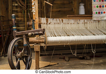 Weaving Loom and thread of yarn - A closeup image of an old...