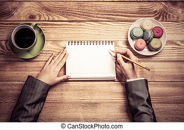 Businesswoman making some notes - Top view of businesswoman...