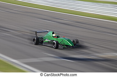 Motion blur of racing car - Race car F2 racing on speed...