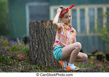 Puzzled  girl sitting near farm
