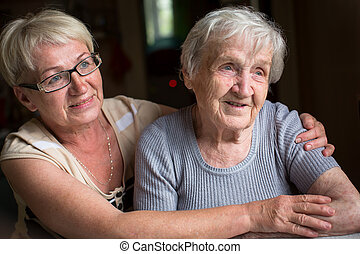 woman with her elderly mother.