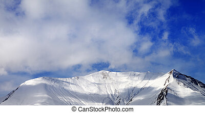 Panoramic view on off-piste snowy slope in wind day Caucasus...