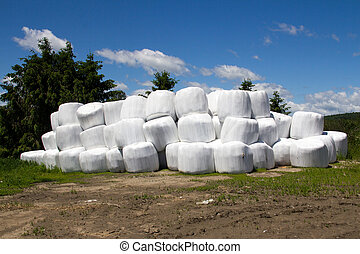 hay roll stack - wrapped hay roll stack