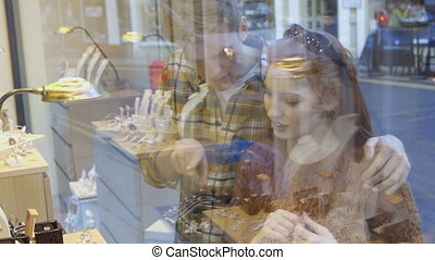 Jewellery Shop Window Shopping - Young couple looking at a...