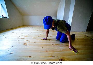 varnished - Wooden floor polishing, before varnished.Worker...