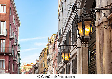 Ancient lamp on Venetian Street in Venice, Italy