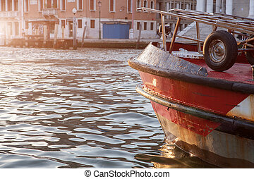 Old boat on the river in Venice, Italy