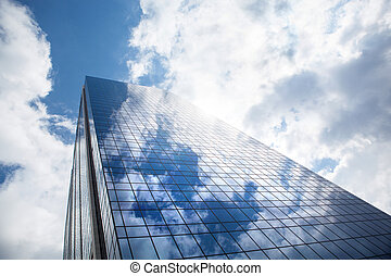 Skyscraper against blue sky - Reflection of the sky and...