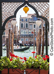 Gondola and houses in Venice - window with flowers and a...
