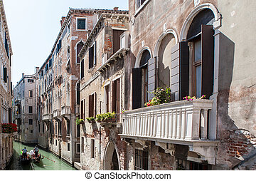 Vintage house with a balcony decorated. Venice, Italy