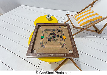 Vintage table game on the porch. For relax.