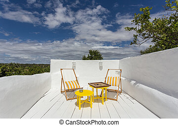 Place to relax a porch on vacation. - Place to relax on a...