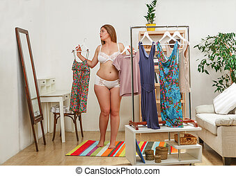 Woman trying dresses at home - Fat woman trying different...