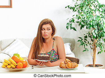 Fat woman sitting at table home - Portrait of beautiful fat...