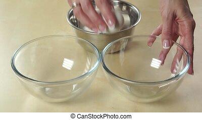 Female hands splitting yolk and egg-white - Slow motion...