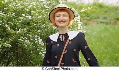 Beautiful redhead young woman dancing, whirling, swinging,...