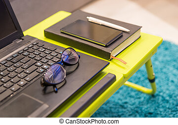 Close up of a modern tabletop workstation with stylish...