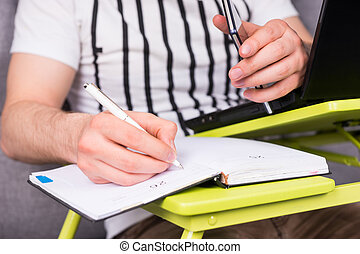 Close up of businessman's hand writing