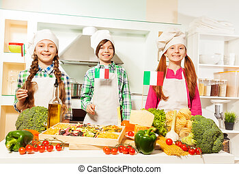 Young cooks preparing traditional Italian meal
