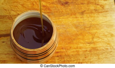 footage barrel of honey on a wooden table close-up.
