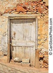 Door of old building in Hersonissos. - Door of old building...