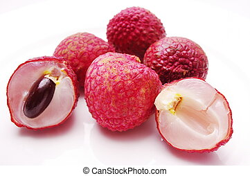 Lychees - full, ripe Lychee fruit showing red peel, dark...
