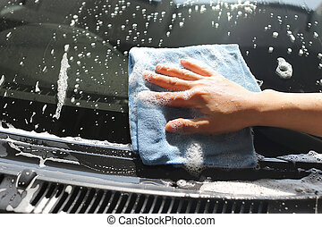Women Hand in Wash a car with Microfiber Cloth - Women Hand...