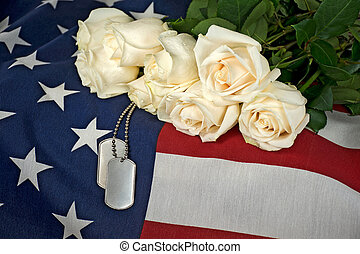 dog tags with rose bouquet - Military dog tags and white...