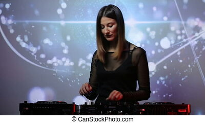 DJ girl on decks at the club