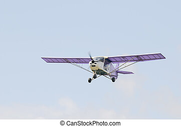 Flying airplane - Flying private propeller-driven airplane...
