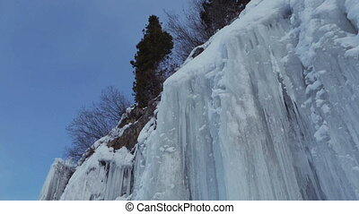 Huge icicles on rocks.