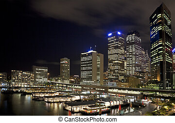 Sydney CBD at night from Circular Keys with ferries and...