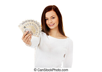 Happy young lady holding cash-polish zloty