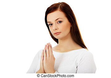 Beautiful young caucasian woman praying