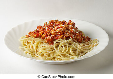 Spaghetti a la Bolognese in the white plate over grey...