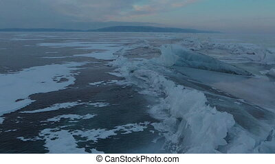 Large blocks of ice crack. Beautiful winter Lake Baikal.