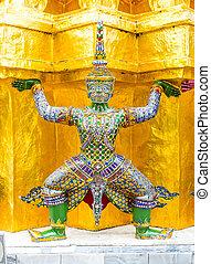 Close up Thai giant statue at golden pagoda at at Grand...