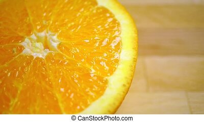 Dolly shot of orange halves, close up video