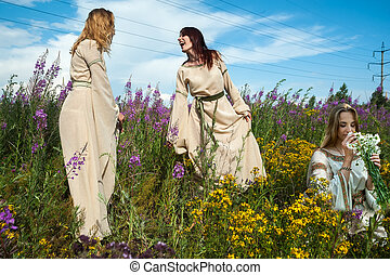 Beautiful women relaxing on fireweed meadow - Attractive...