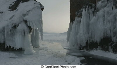 Rock near island Lohmaty. Beautiful winter Lake Baikal.
