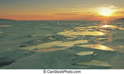 Sunset at Holy Nose Peninsula. Beautiful winter Lake Baikal.