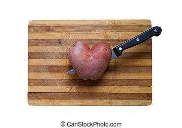 love cooking potatoes - horizontal top view of a heart...